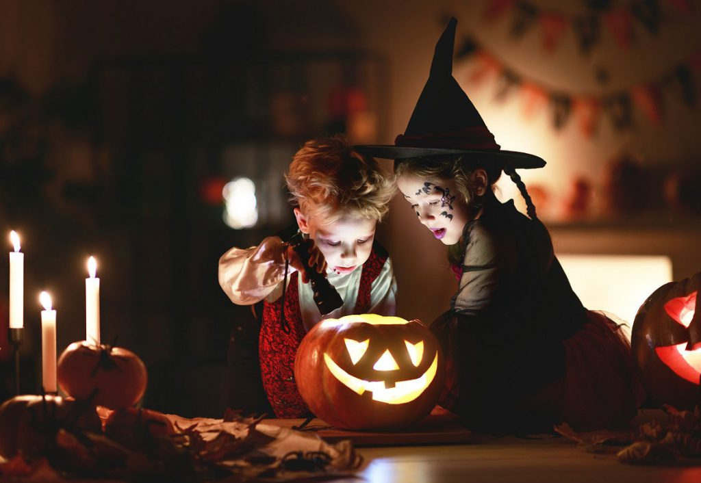 Kids at halloween with pumpkin
